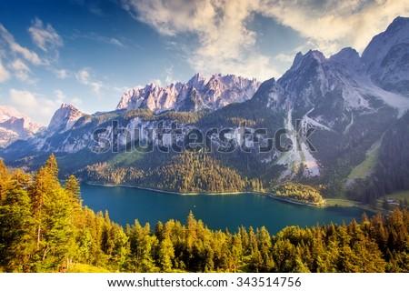 Fantastic alpine lake Vorderer Gosausee. Picturesque scene. Salzkammergut is a famous resort area located in the Gosau Valley in Upper Austria. Gosaukamm range and Dachstein glacier. Beauty world. - stock photo