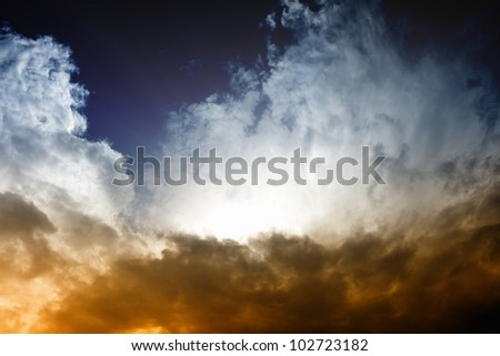 Fantastic background - dark sky and bright light from sun - stock photo
