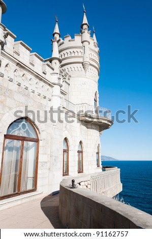 Fantastic castle: Swallow's Nest Castle tower, Crimea, Ukraine, with blue sky and sea on background - stock photo
