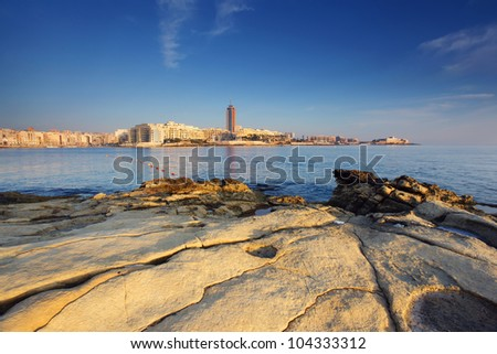 Fantastic city landscape on the seaside with boats. Portomaso Business Tower, Malta. - stock photo