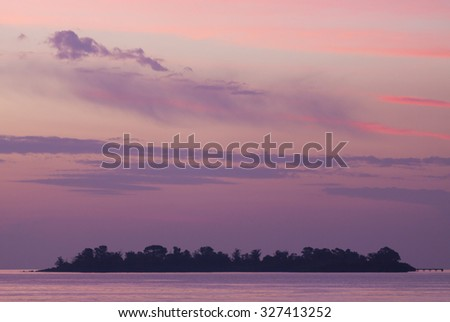 Fantastic colored sunset on the river Rio de la Plata. A tapering intrusion of the Atlantic Ocean on the east coast of South America between Uruguay to the north and Argentina to the south. - stock photo