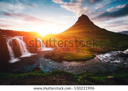 Fantastic evening with Kirkjufell volcano the coast of Snaefellsnes peninsula. Picturesque and gorgeous morning scene. Location famous place Kirkjufellsfoss waterfall, Iceland, Europe. Beauty world.