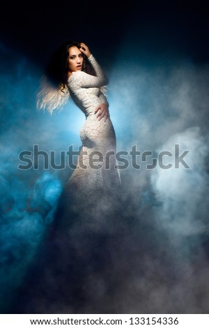 Fantastic girl in white lace dress - stock photo