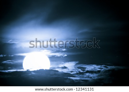 Fantastic glowing moon bathing in a dark blue night sky - stock photo