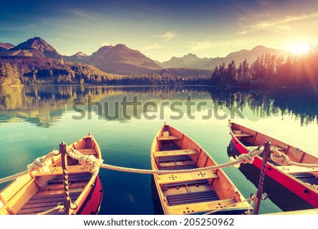 Fantastic mountain lake in National Park High Tatra. Dramatic scenery. Strbske pleso, Slovakia, Europe. Beauty world. Retro style filter. Instagram toning effect. - stock photo