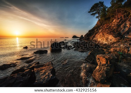 Fantastic panoramic view of the rocky coast of the sea in the evening at sunset. Turkey