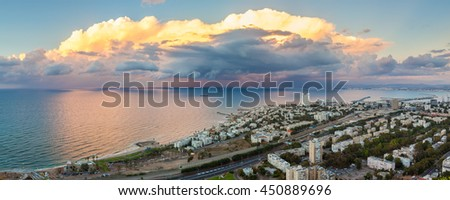 Fantastic panoramic view of the sunset over the Mediterranean sea. Shot from Stella Maris, Haifa bay, Israel. - stock photo