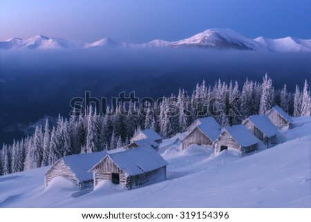 Fantastic pink evening landscape glowing by sunlight. Dramatic wintry scene with snowy house. Carpathians, Ukraine, Europe. - stock photo