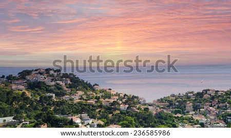 Fantastic pink sunset over old port small hill with sea in Marseille , France - stock photo