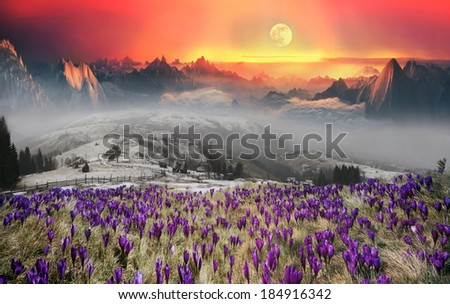 Fantastic scenery ... Sunset Alpine Mountain impresses with its colorful and predicts the storm. On the background painted last rays of the sun-lit vertices blaze clouds and a huge moon hanging - stock photo