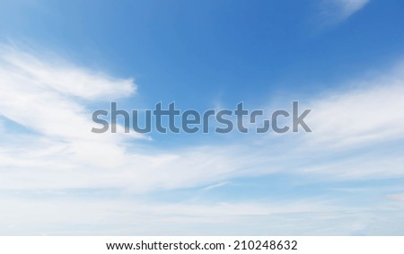 Fantastic soft white clouds against blue sky.