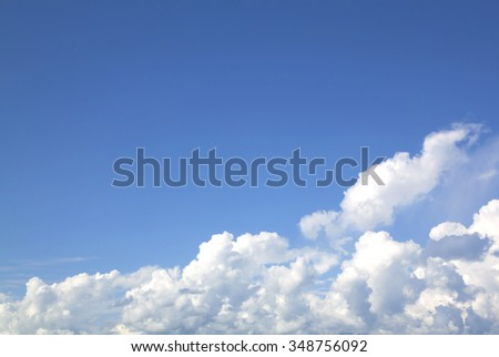 Fantastic soft white clouds against blue sky background, soft focus.