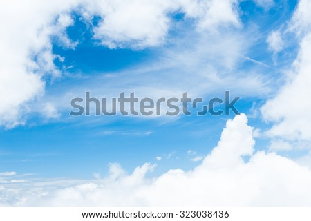 Fantastic soft white clouds against blue sky background with tiny clouds. - stock photo