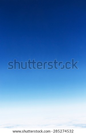 Fantastic soft white clouds against blue sky, take a picture on the airplane. - stock photo