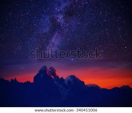 Fantastic starry sky over the mountain Ushba. Dramatic and unusual scene. Location Mestia, Upper Svaneti, Georgia, Europe. High Caucasus ridge. Astrophotography. Beauty world. - stock photo