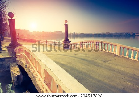 Fantastic sunny day on the lake. Ternopil, Ukraine, Europe. Beauty world. Retro style filter. Instagram toning effect. - stock photo