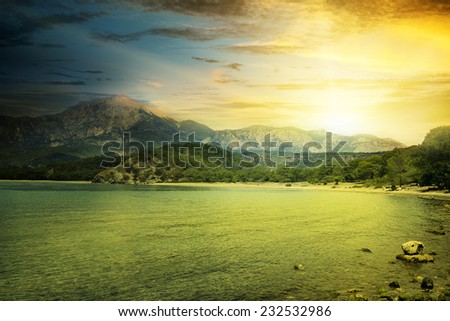 fantastic sunrise on the beach - stock photo