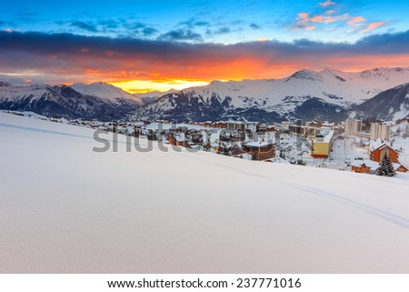 Fantastic sunrise,winter landscape and ski resort in French Alps,La Toussuire,France,Europe - stock photo