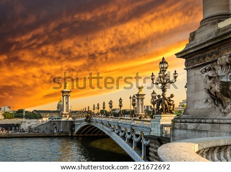 Fantastic  sunset over Alexandre III bridge (Pont Alexandre III) and the National Residence of the Invalids, Paris, France - stock photo