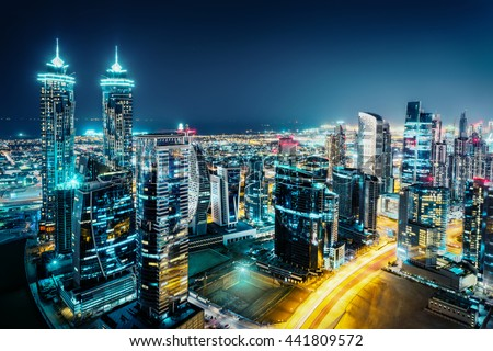 Fantastic view of a big city at night with illuminated modern architecture. Dubai downtown, United Arab Emirates.