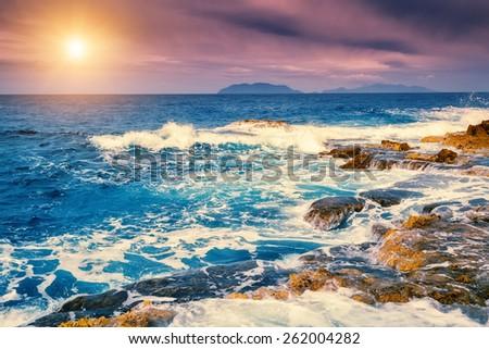 Fantastic view of the cape Milazzo (Piscina di Venere) and Lipari island. Dramatic scene. Overcast sky. Tyrrhenian sea. Sicilia, Italy, Europe. Beauty world. Retro style filter. Instagram effect. - stock photo