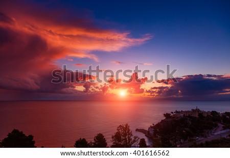 Fantastic view of the dark overcast sky. Dramatic and picturesque morning scene. Location: cape Capo Zafferano. Island Sicilia, Italy, Europe. Mediterranean and Tyrrhenian sea. Beauty world. - stock photo