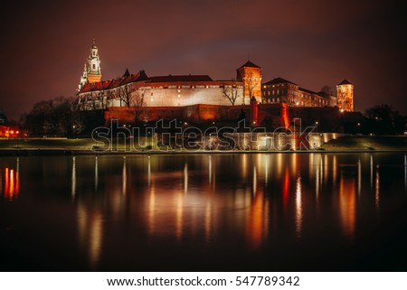 Fantastic view of the night KRAKOW. The Royal Wawel Castle as seen from another bank of Vistula in Krakow, Poland, Europe