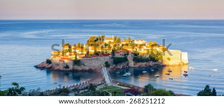 Fantastic view of the Sveti Stefan, small islet and resort in Montenegro. Clear morning scene. White fluffy clouds. Balkans, Adriatic sea, Europe. Beauty world. - stock photo
