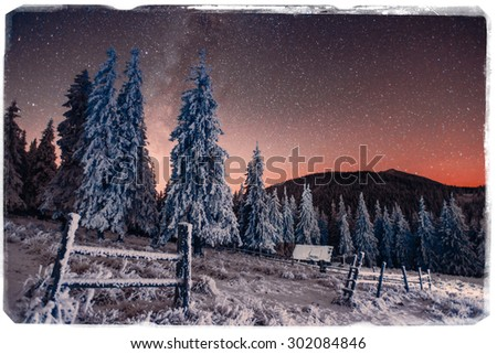 fantastic winter meteor shower and the snow-capped mountains. Vintage effect - stock photo