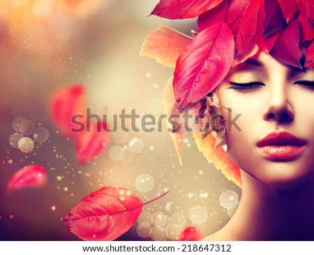 Fantasy Autumn Woman Fashion Portrait. Fall. Beautiful Model Girl with colourful autumn leaves hairstyle. Fashion Art design with copyspace for your text - stock photo