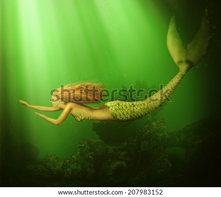 Fantasy. beautiful woman mermaid with fish tail and long developing hair swimming in the sea underwater - stock photo