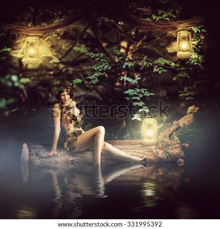 Fantasy fairytale beautiful woman - wood nymph or dryad sitting about water, sail on a log - stock photo