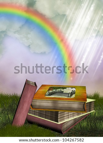 fantasy fairytale story books in the garden with rainbow - stock photo