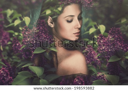 fantasy forest fairy surrounded by flowers - stock photo