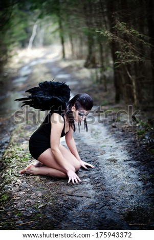 Fantasy image with a fallen angel - stock photo