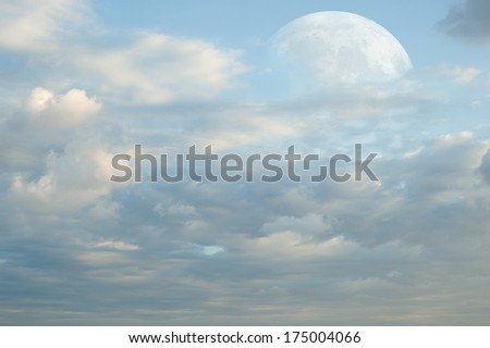 Fantasy Landscape. Super Moon behind blue pink clouds  - stock photo