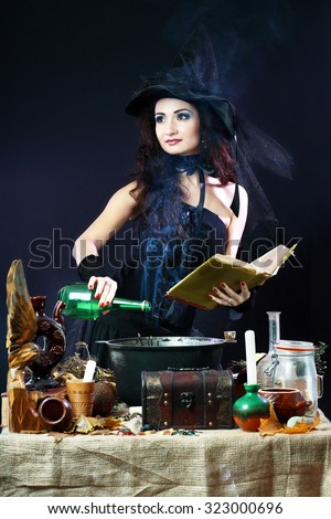 Fantasy magic portrait of sexy beautiful woman making spell  - stock photo