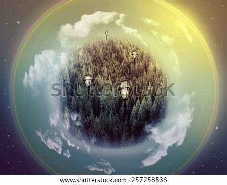 Fantasy picture with a green planet, lamps and universe with stars - stock photo