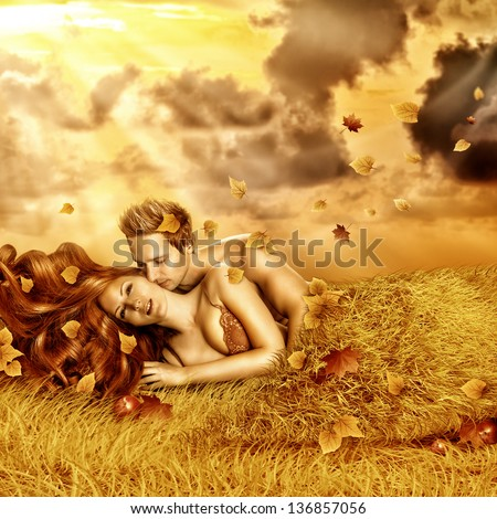 Fantasy romantic collage. Loving fairy couple  lying in bed of yellow grass, leaves outdoor in autumn sunset. Tender Lovers have sex - stock photo
