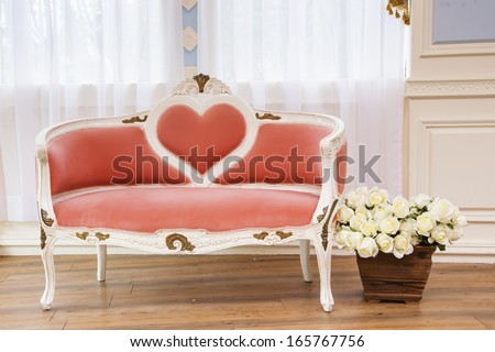 Fantasy room with a heart sofa - stock photo