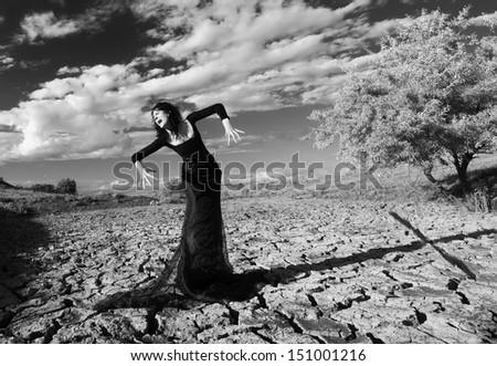 Fantasy style portrait of a howling demonic woman, monochromatic shot - stock photo