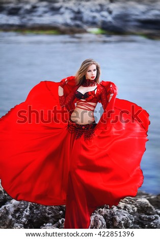 Fantasy style portrait of woman in red dress