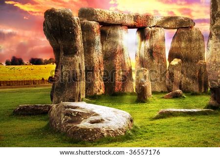Fantasy sunrise at Stonehenge with dramatic sky and sun rays - stock photo