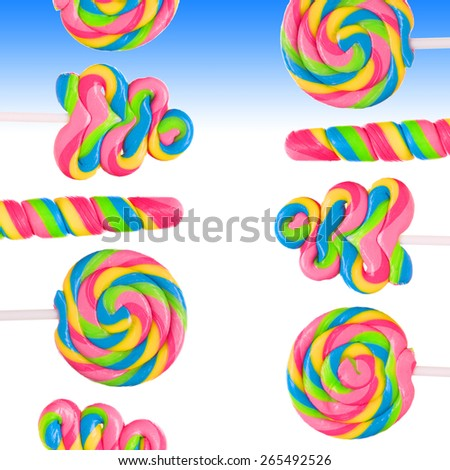 Fantasy sweet candy land with lollies on blue background - stock photo