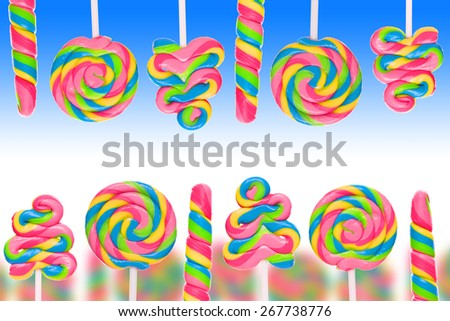 Fantasy sweet candy land with lollies on blue background