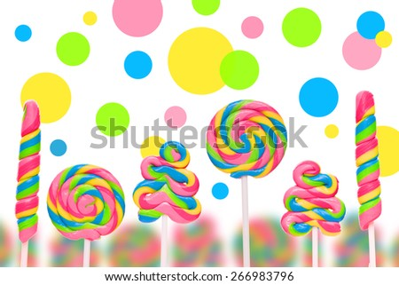 Fantasy sweet candy land with lollies on white background - stock photo