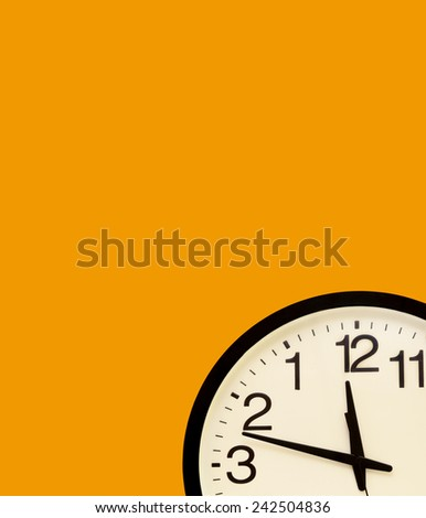 Fantasy wall clock in the border with the order of the numbers inverted - stock photo