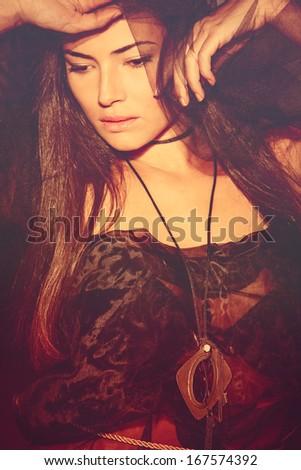 fantasy woman in red studio shot - stock photo