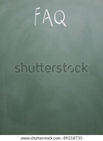 FAQ title handwritten with chalk on blackboard - stock photo