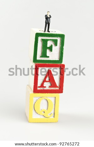 Faq word and toy business man - stock photo